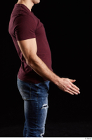 Tomas Salek  1 arm dressed flexing red t shirt side view 0002.jpg